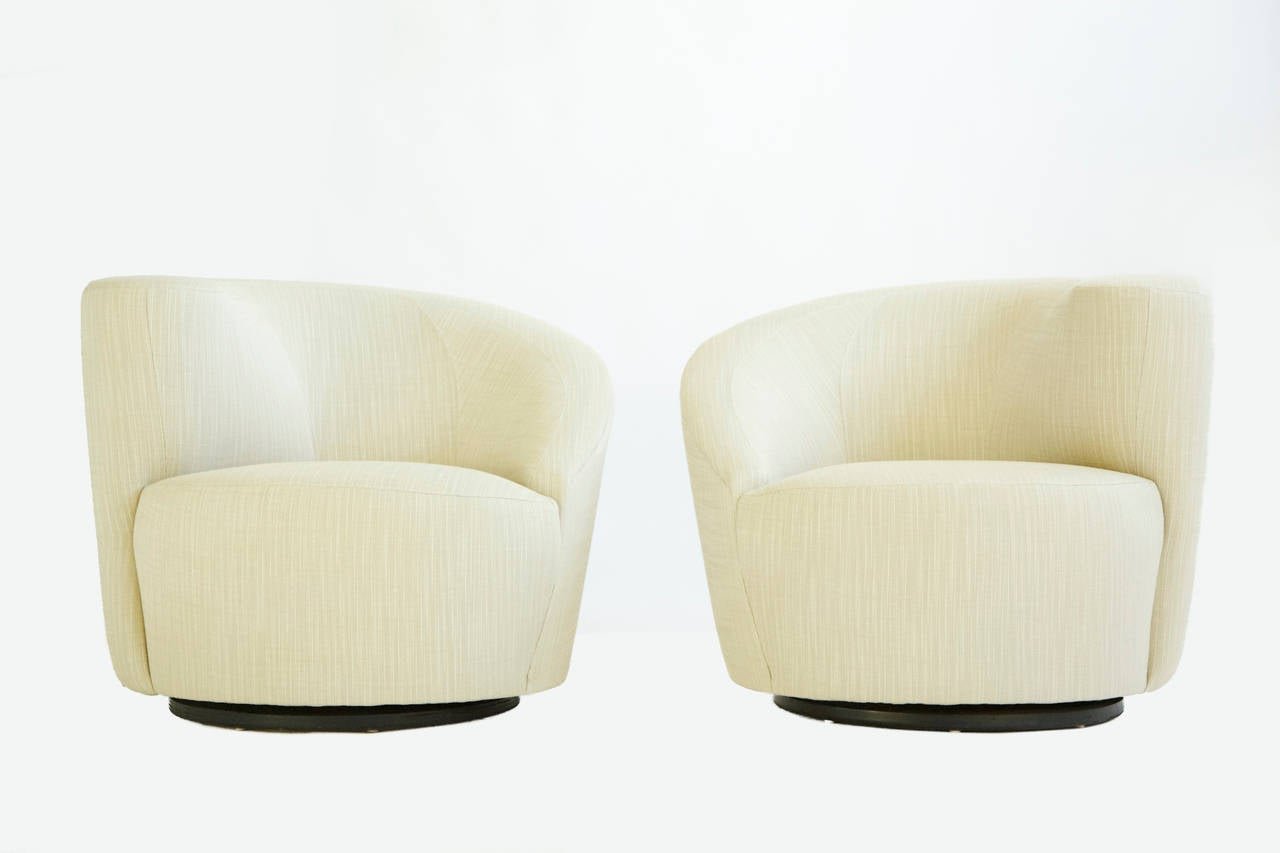 Kagan swivel lounges for Directional. New foam and reupholstered with great plains cotton-poly fabric.  Signed with label on underside [Directional.].