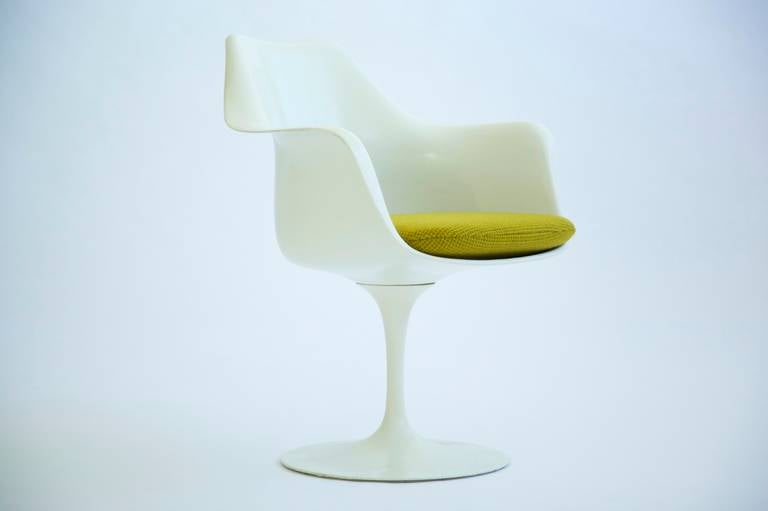 Saarinen for Knoll International, vintage white tulip swivel armchair. Reupholstered with green Cato wool fabric a Knoll textile. [Signed label Knoll International]