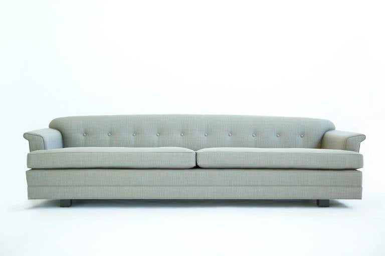 Wormley for Dunbar sofa, model 488, features arched back and angled wing arms. Seat cushions and pillows are down filled. signed deck [Dunbar] repeat  This item is currently on view in our NYC Greenwich Street Location.