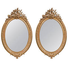 Pair of Oval Gilded Mirrors