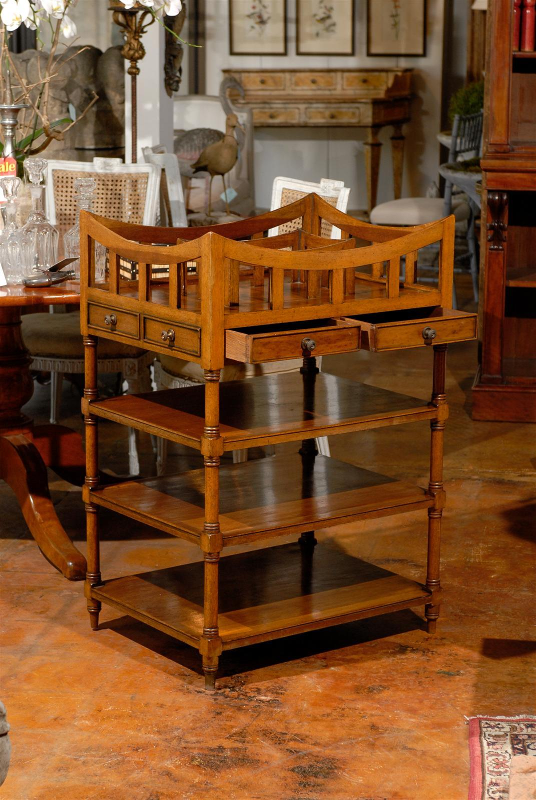 An Italian walnut étagère with pierced gallery and two-drawers from the late 19th century. This Italian wooden tiered shelf circa 1890 features an unusual curved pierced gallery at the top, surrounding a smaller partitioned gallery. The apron