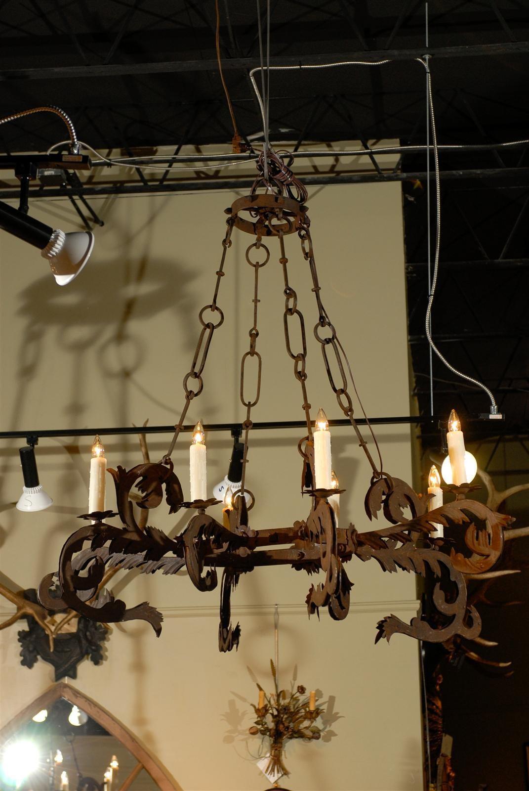 Pair of florentine 1720s gothic revival eight light wrought iron a pair of florentine early 18h century eight light gothic revival wrought iron chandeliers arubaitofo Choice Image