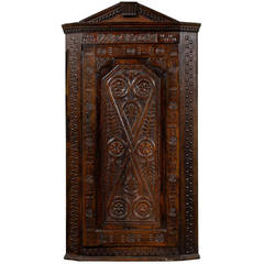 Early 18th Century English Carved Corner Cupboard