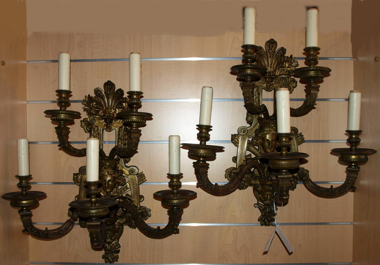 Exquisite pair of five light gilt bronze Regence style sconces with incredible detail