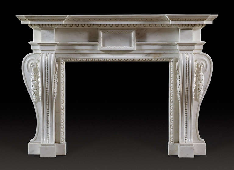 In white statuary marble of strong, bold design, based on an Inigo Jones / William Kent design with well sculpted crisp mouldings and falling foliate drops. A good and handsome chimney piece with austere grandeur and presence so typical of the