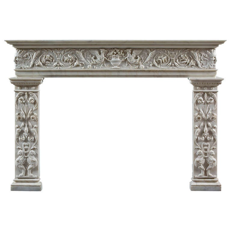 an antique carved statuary marble fireplace mantel of