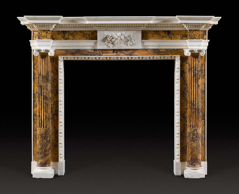 This chimneypiece closely follows typical designs of Inigo Jones and William Kent first popularised in late 1720s and later in the 1750s by Isaac Ware. The statuary shelf protrudes over the centre and the jambs. The lower part of the cornice with