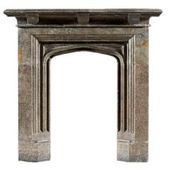 An antique 19th Century sandstone Gothic fireplace mantel