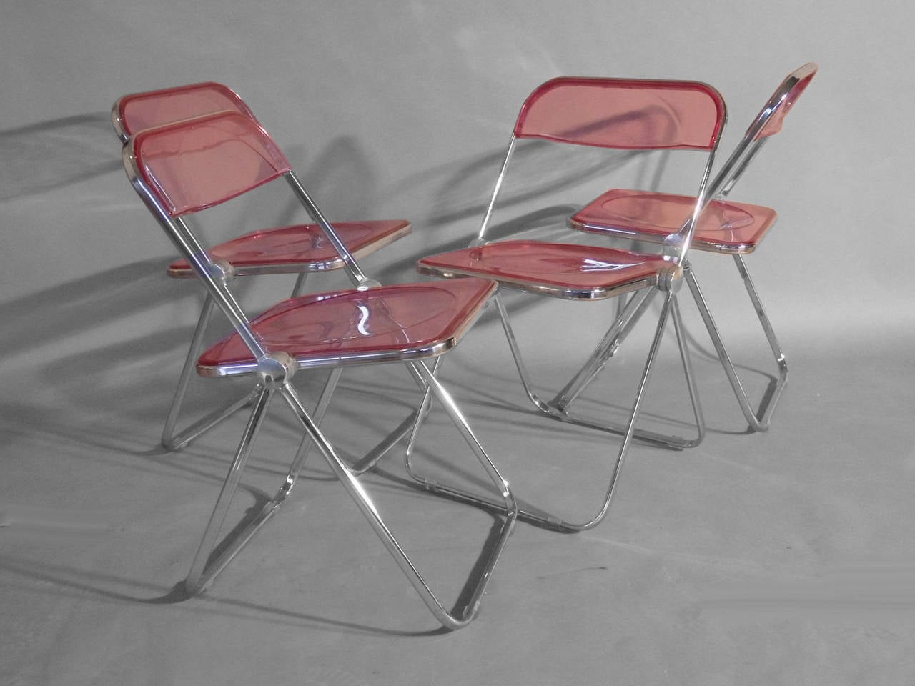 Set of Four Plia Lucite Aluminum and Chrome Folding Chairs at 1stdibs