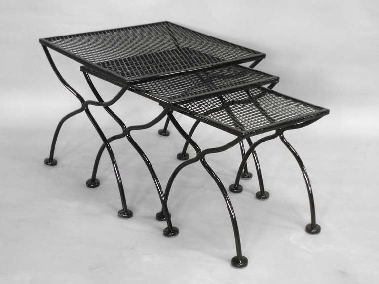 Wrought iron and mesh nest of outdoor tables by russell