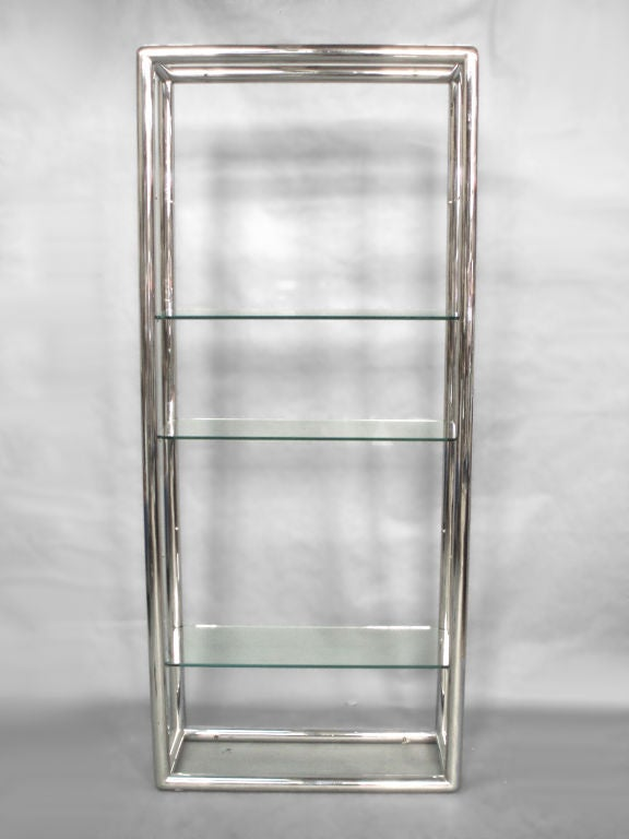 Glass and polished stainless steel shelf unit possibly pace. Five 3/8 thick glass shelves plus top and bottom. Some chips to edge of glass at mounting points.