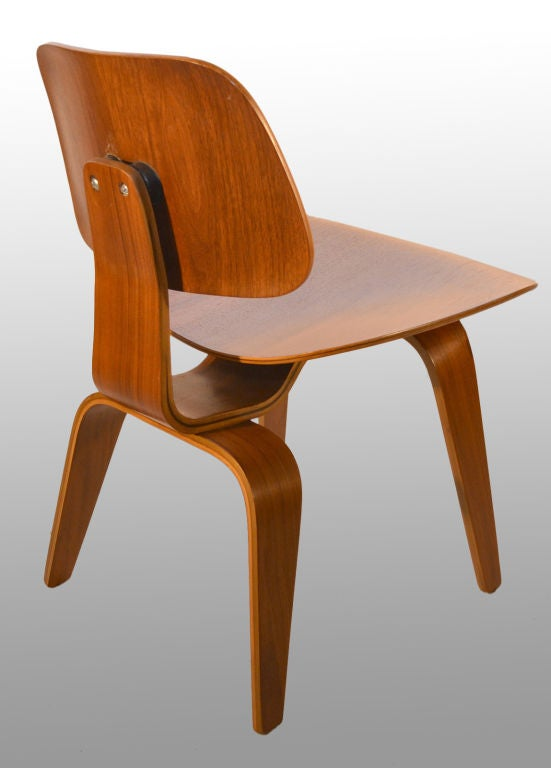 Set Of Four Eames DCW Dining Chairs Wood At 1stdibs