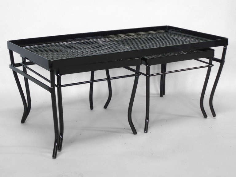 Nest of wrought iron and mesh tables by russell woodard