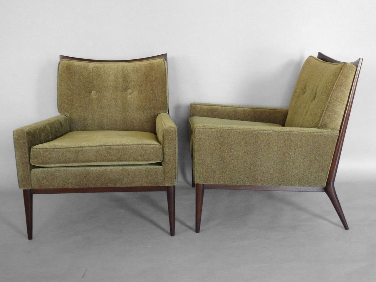 Pair of lounge chairs by Paul McCobb for Directional Furniture. Bases refinished and freshly re upholstered .