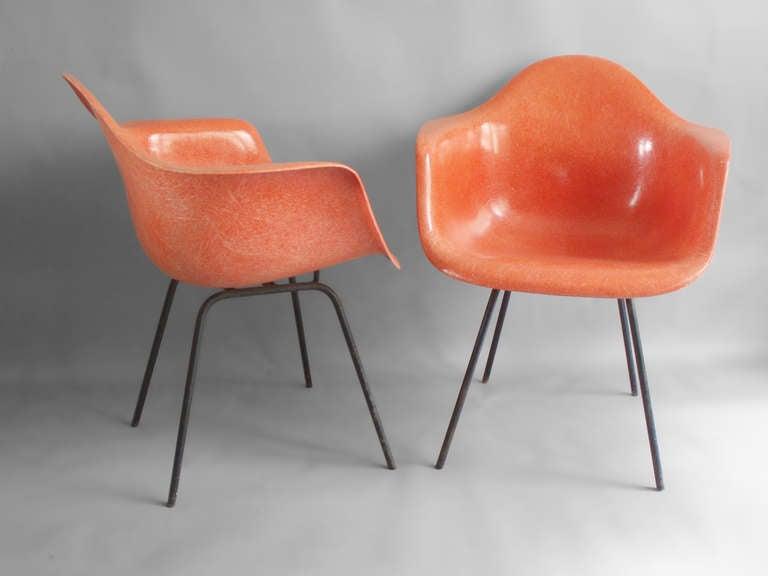 pair salmon toned fiberglass bucket chairs by charles. Black Bedroom Furniture Sets. Home Design Ideas