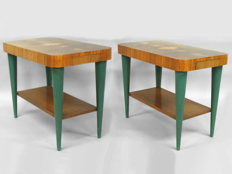 Pair of Art Deco moderne burl top tables by Gilbert Rohde for Herman Miller. Beautifully refinished burl tops on original green oil cloth covered legs . Very nice example and a pair .