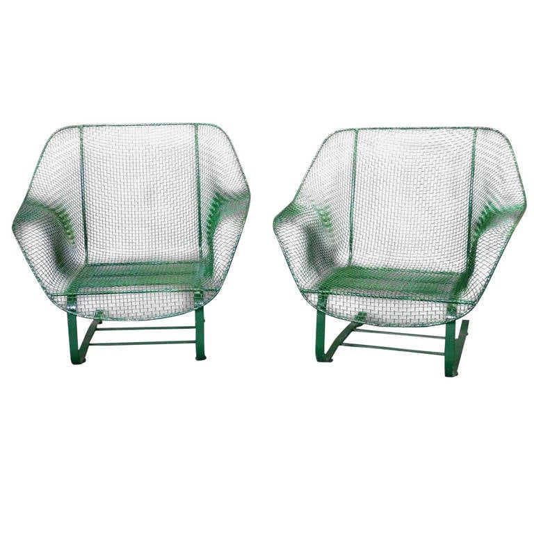 Pair of wrought iron with wire mesh woodard cantilever chairs at 1stdibs