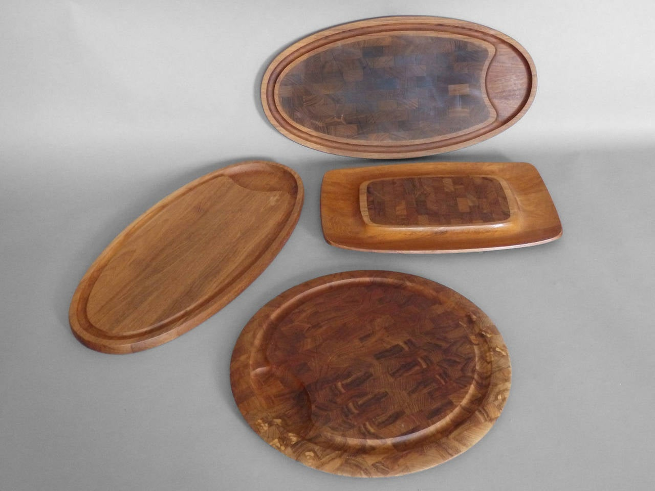 Collection of cutting board trays by JHQ Jens Quistgaard for Dansk.