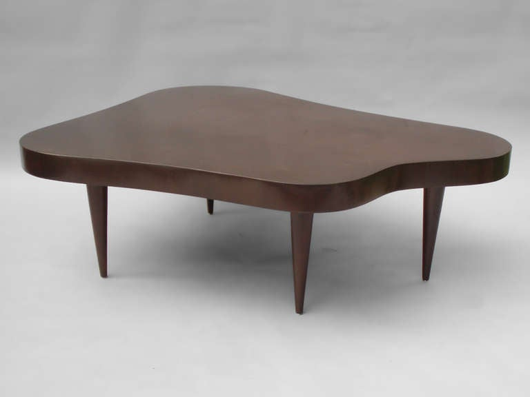 biomorphic free form coffee table in the style of gilbert rohde at