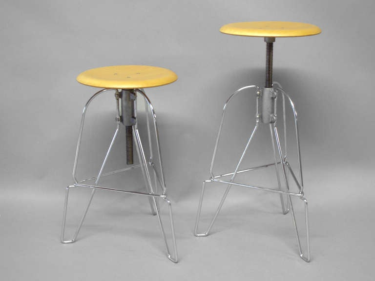 Pair of Industrial chic steel and wood adjustable bar stools by Jeffrey Corey. Measure: Height adjusts 25