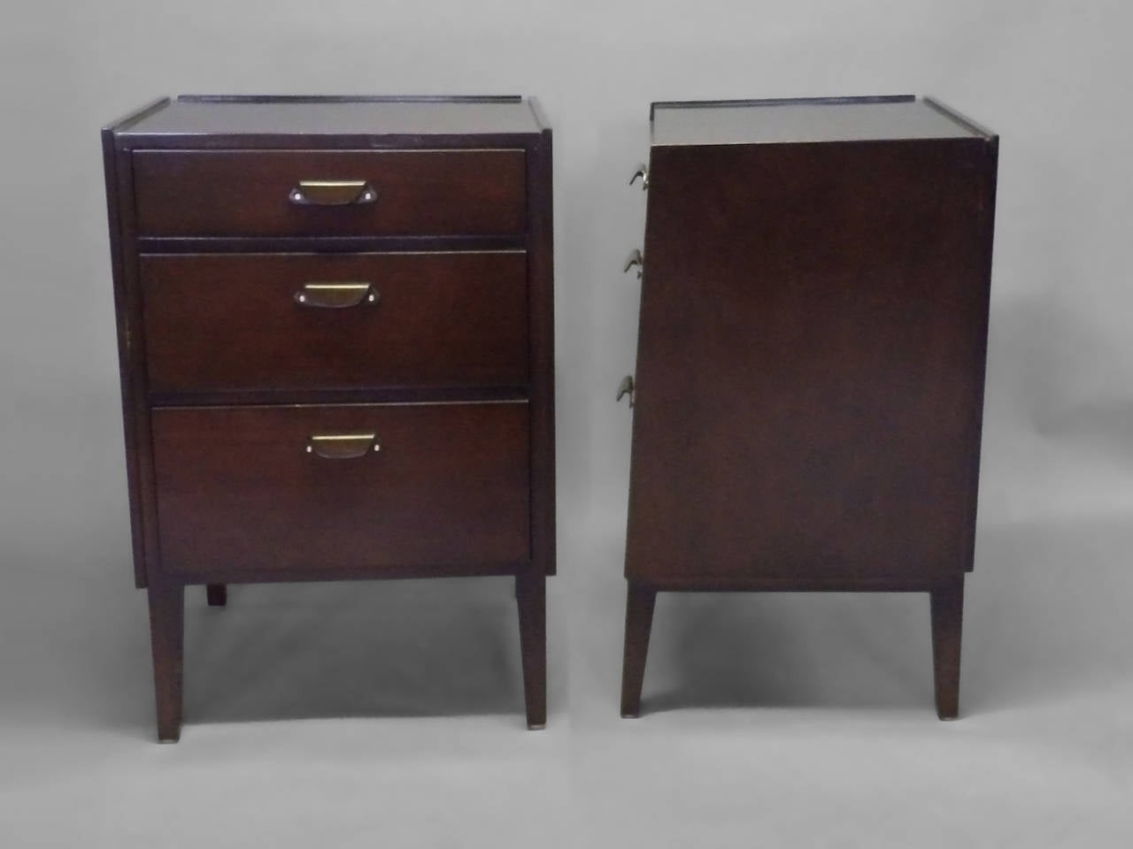 Pair of Edward Wormley for Dunbar angle front nightstands.