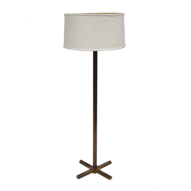 this cruciform base brass reading floor lamp by robsjohn gibbings is. Black Bedroom Furniture Sets. Home Design Ideas