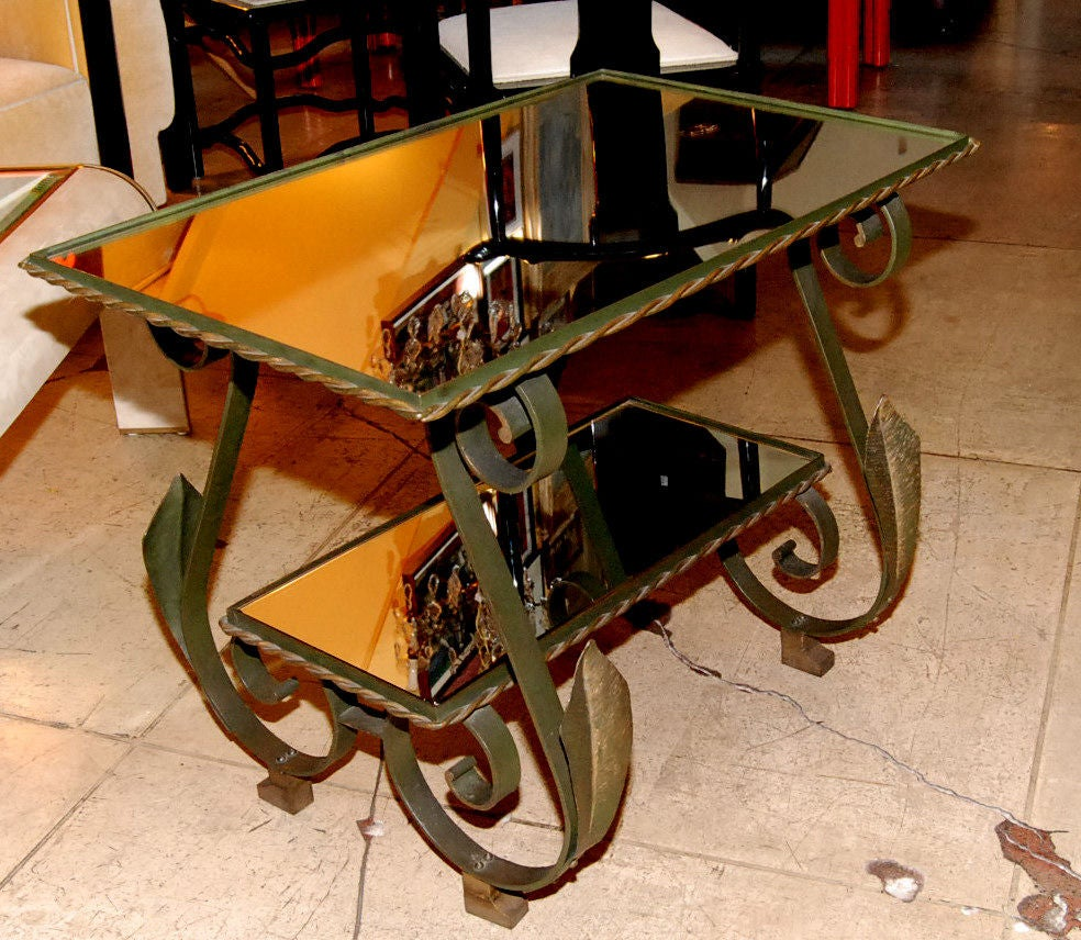 Two tiers wrought iron side table in the style of Gilbert Poillerat.