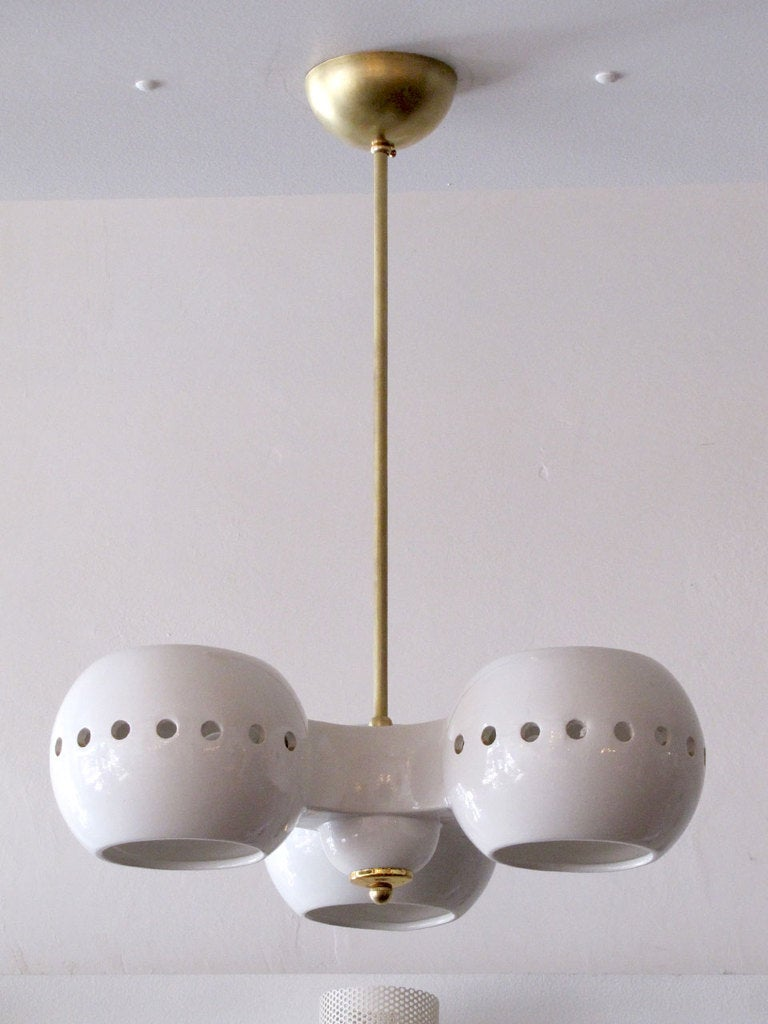 Ceramic chandelier by kaiser at 1stdibs white ceramic three light chandelier by kaiser germany the perforated ceramic corpus is suspended from arubaitofo Image collections