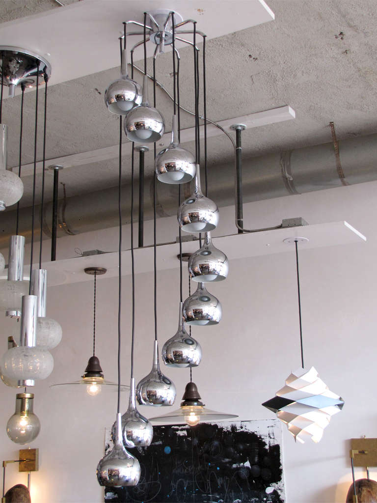 stunning 1960s cascading chandelier attributed to Hans-Agne Jacobsson, with ten individual drop-shaped chrome plated pendants measures: 7.5in. x 4.5in., adjustable in length and configuration, current total drop 56