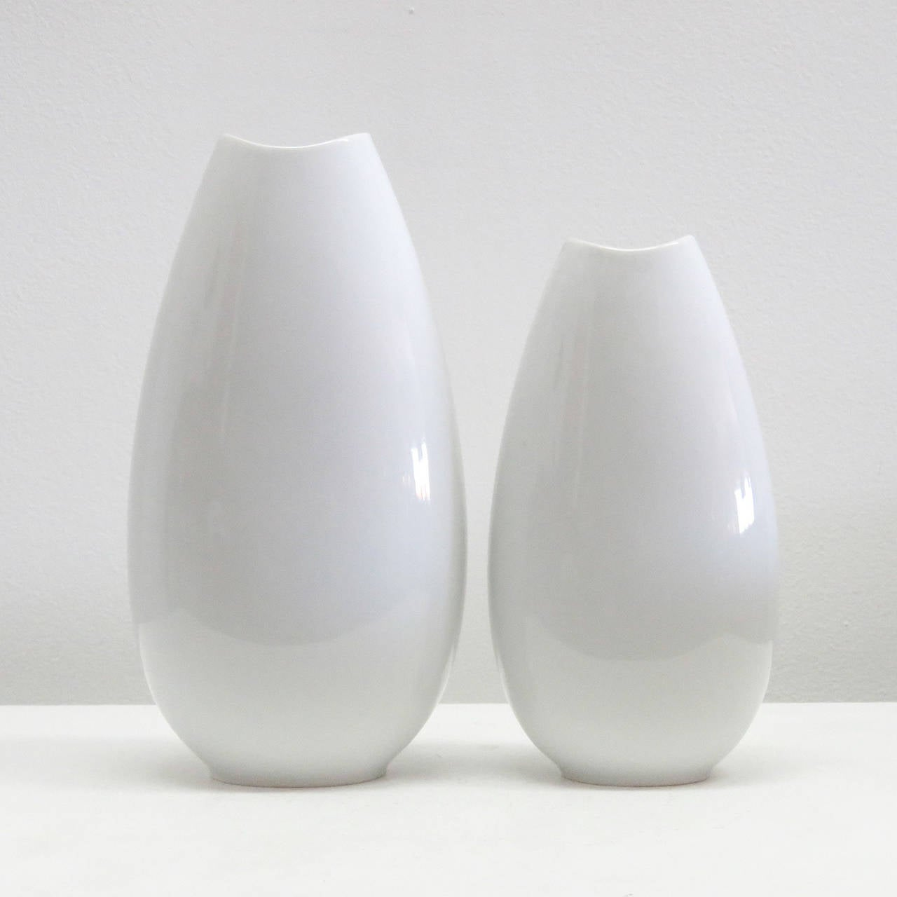 "Wonderful set of 1970s all white German ""Fischmaul"" vases by Thomas, two different sizes (H=11 W=5.75"" D=4.0"" and H=9.25"", W=5.0"", D=3.5"")."