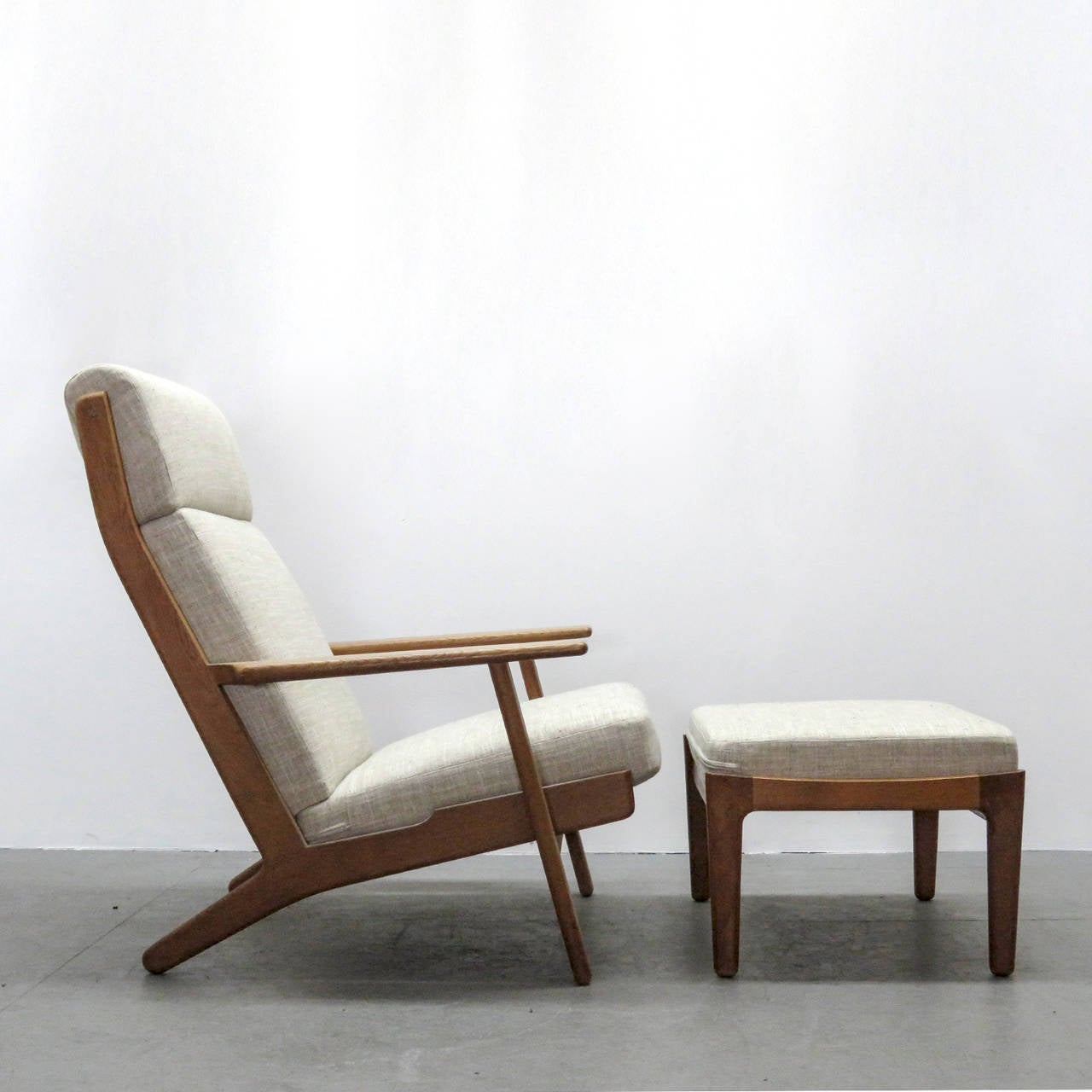Danish Hans J. Wegner GE 290 High Back Chair And Ottoman For Sale