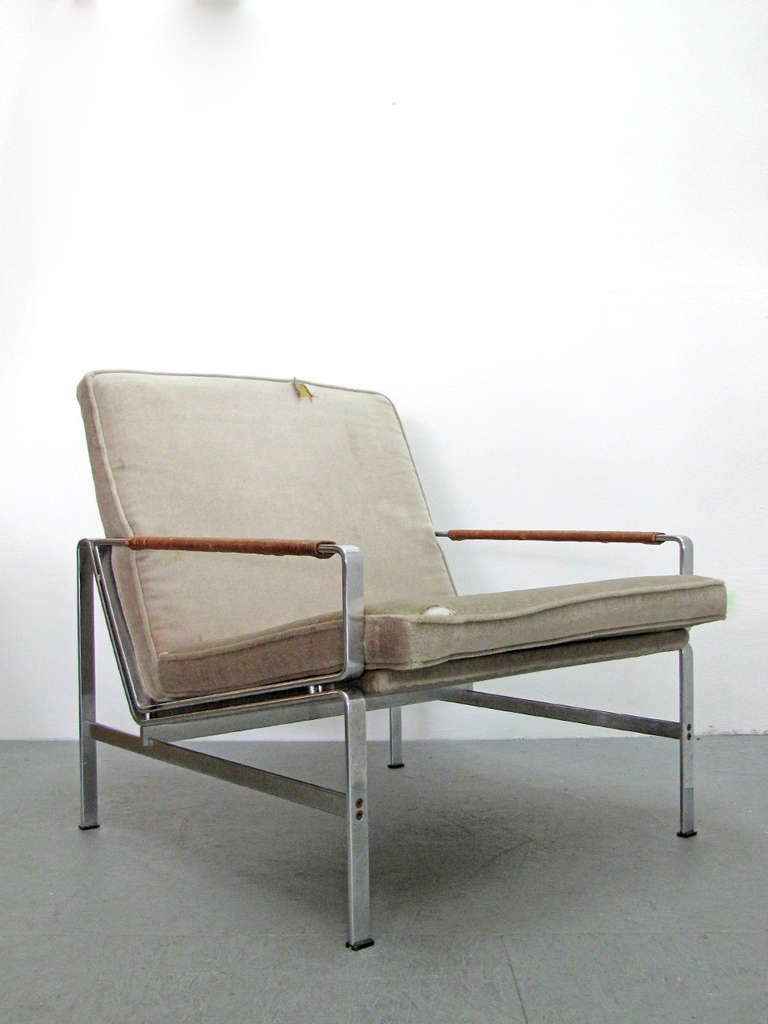 an original Fabricius & Kastholm easy chairs in steel with leather wrapped arm rests, original tan/grey upholstery