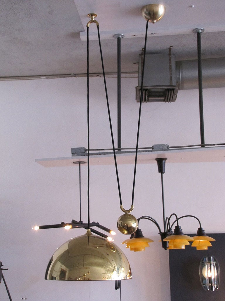 beautiful brass counterweight pendant with very heavy sphere pulley mechanism current extension capability from 12