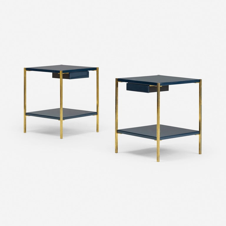 Each table features a single drawer. Signed with impressed manufacturer's marks to underside of each example: [Made in France Charles & Fils]. These nightstands are exceptionally chic. Blue lacquered shelves play off the golden brass frames,