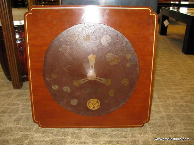 An interesting and decorative 19th century Japanese Jingasa (traveling hat), with brown background and gold crest, vines and leaves.    Hanging on cashew lacquer panel with hand-painted gold border, with hanging hardware on back. (Panel made in