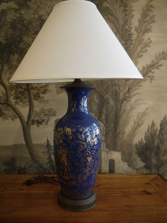 A beautiful large-scale Chinese antique cobalt blue lamps with gilt floral and vine design. The base has been drilled, and this is now electrified. Price includes shade shown. Vase alone is 18 inches high  Total lamp height is 30 inches overall