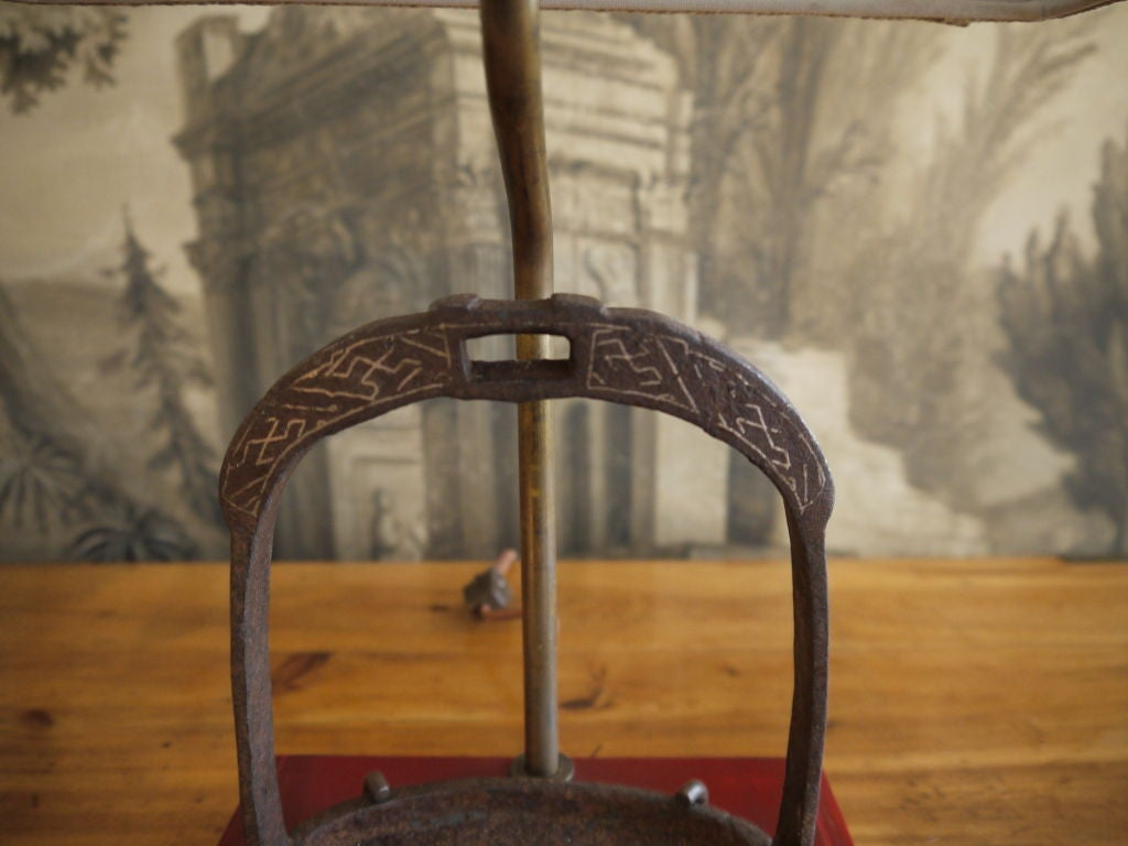A pair of antique Chinese metal stirrups with silver inlay.