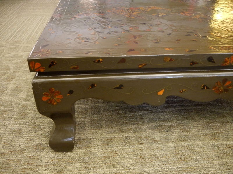 A low Korean table, with inlay of tortoise shell and metal in the shape of a dragon.