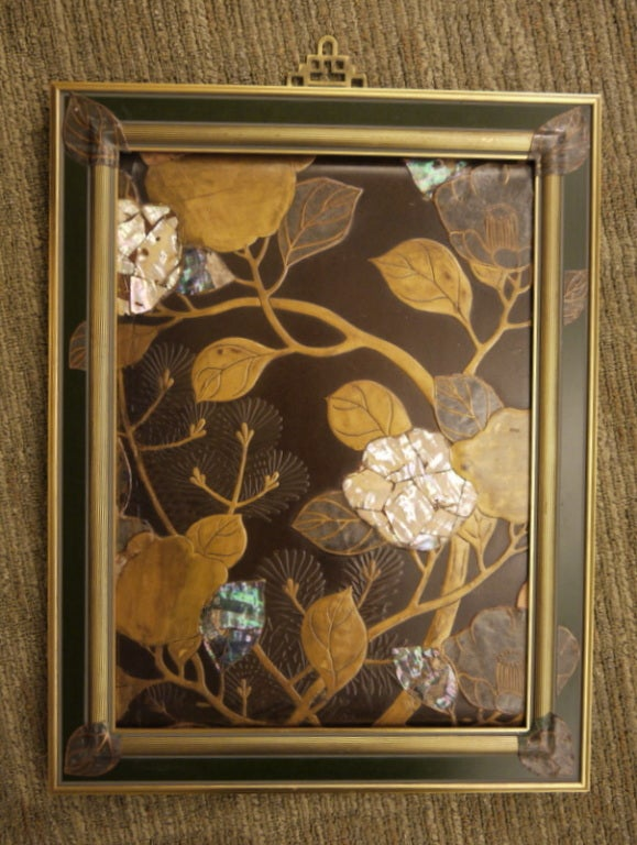 A beautiful two sided Japanese lacquer panel with design of flowers, leaves and branches.  Design is different on both sides.  Decorated in lacquer, with mother of pearl.  