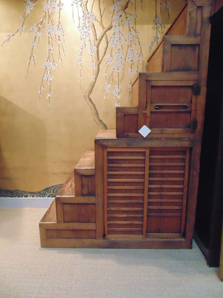 A large late 19th-early 20th century Japanese staircase Tansu, with sliding doors, and eight steps.