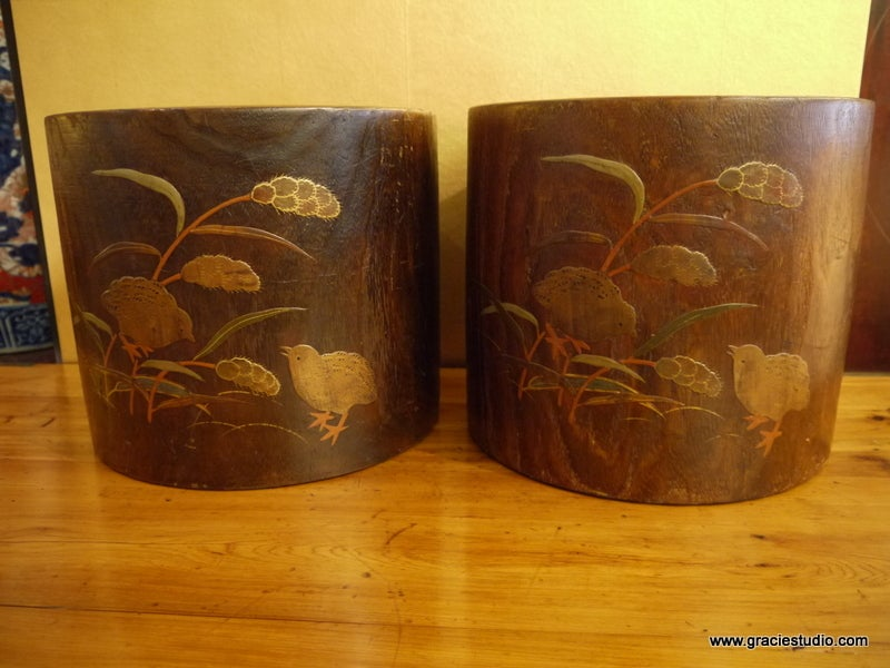 A pair of Japanese wood hibachis, with copper liners.  Design of vines, chicks and wheat on exterior.