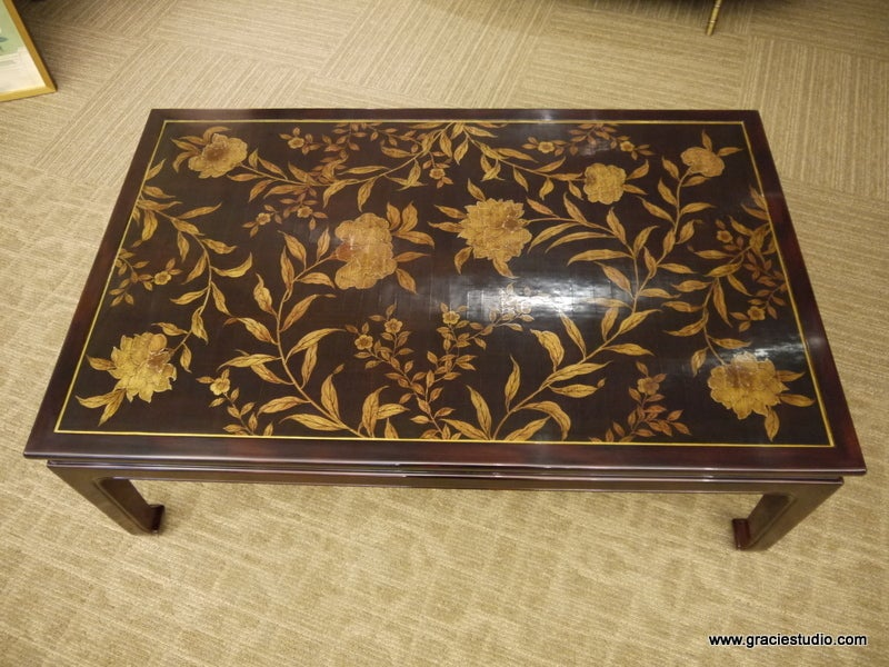 Coffee table with hand-painted floral design in gold, and handmade lacquer finish in very dark brown.