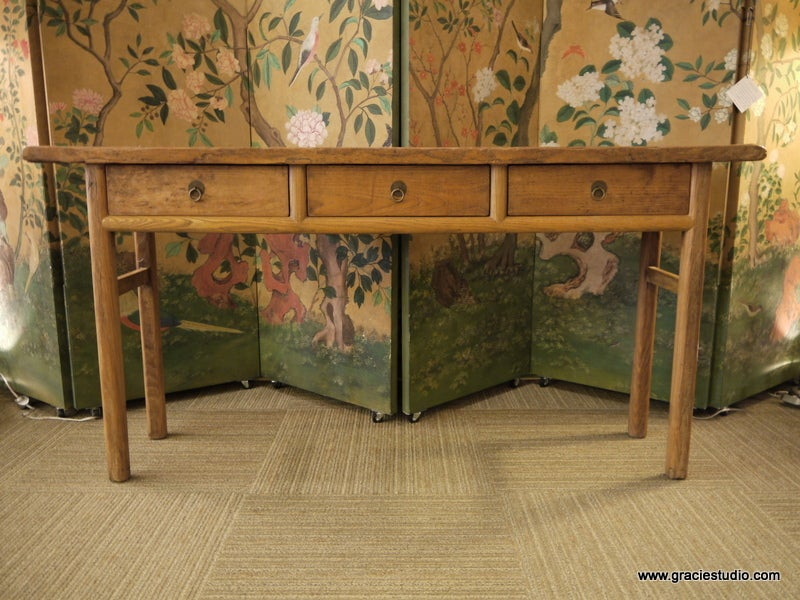 Antique Chinese long elmwood table with three drawers in apron and metal hardware.
