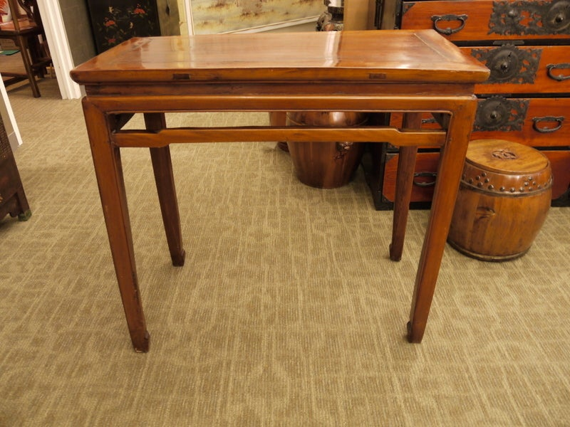 Small and attractive Chinese 19th century console table of simple form, with stretcher. Elmwood.