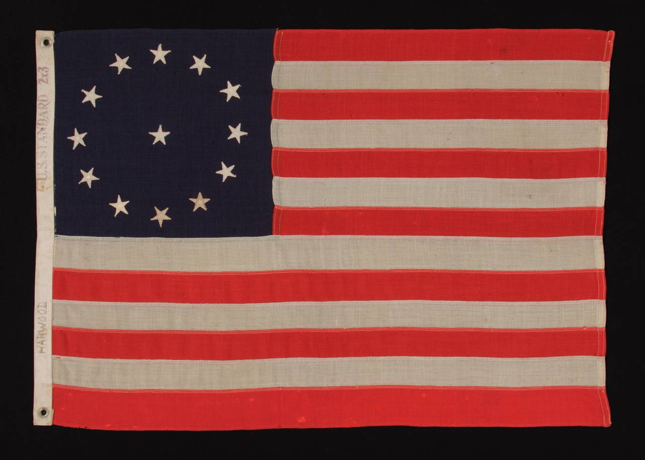 13 STARS IN A CIRCULAR VERSION OF THE 3RD MARYLAND PATTERN, ON A SMALL SCALE FLAG MADE IN THE 1890-1920's ERA:  Small scale 13 star flag of the type made from roughly the last decade of the 19th century through the first quarter of the 20th