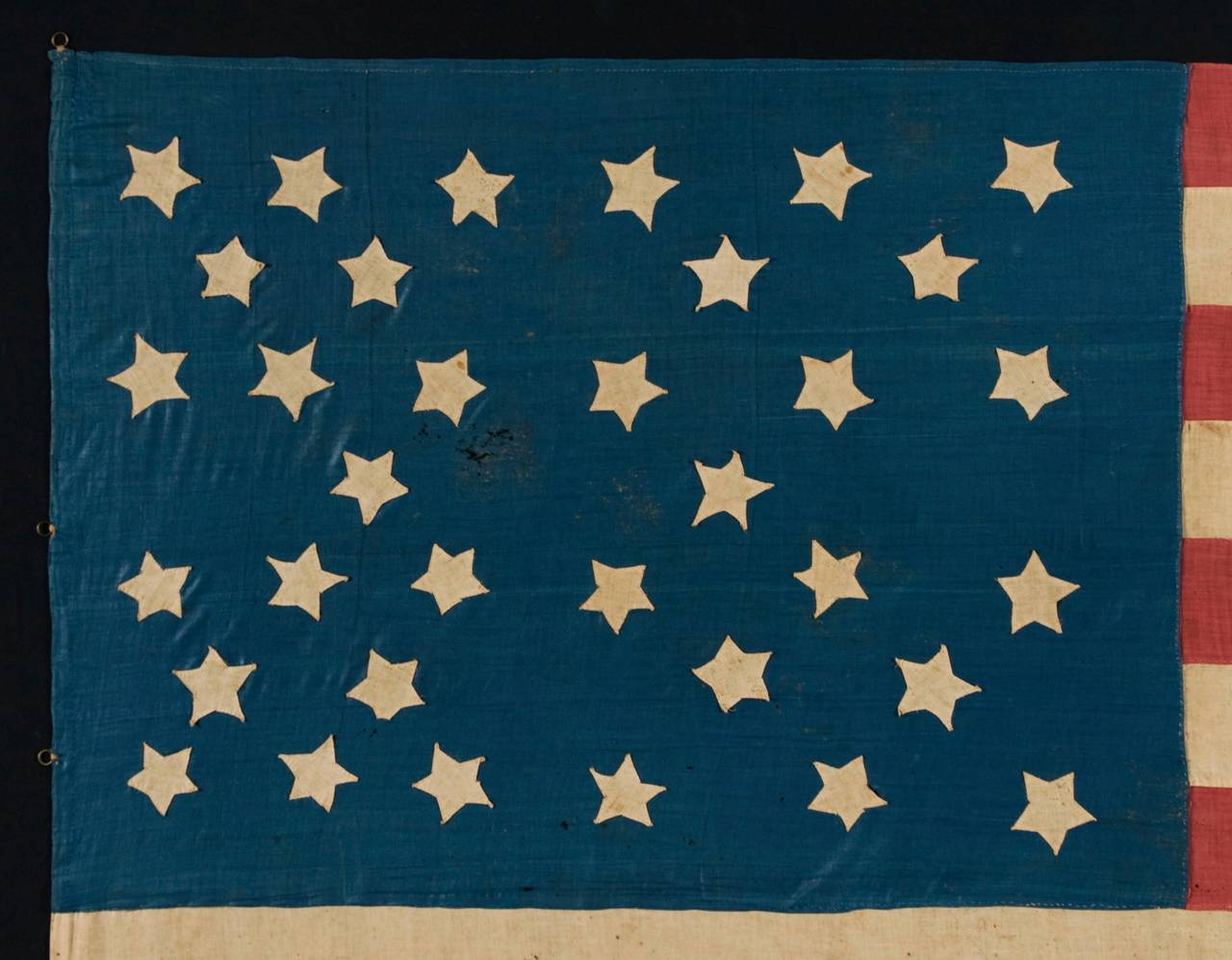Homemade 34-star civil war flag with its stars arranged on a cornflower blue canton in a very interesting configuration that incorporates the crosses of St. Andrew and St. George, possibly made with southern sympathies, 1861-1863: