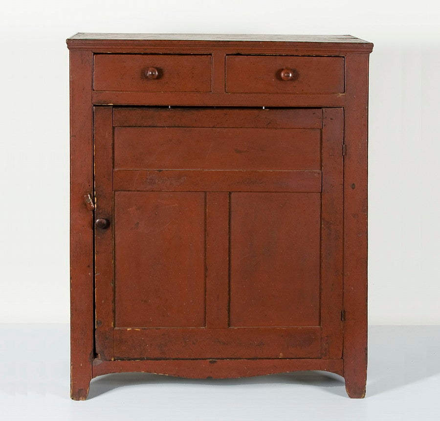 A nice, early, Pennsylvania preserve cupboard with two-drawer over one-door arrangement, a gently scalloped skirt and swag bootjack feet. This particular style, with a single door having one-over-two panel configuration and plank sides, is