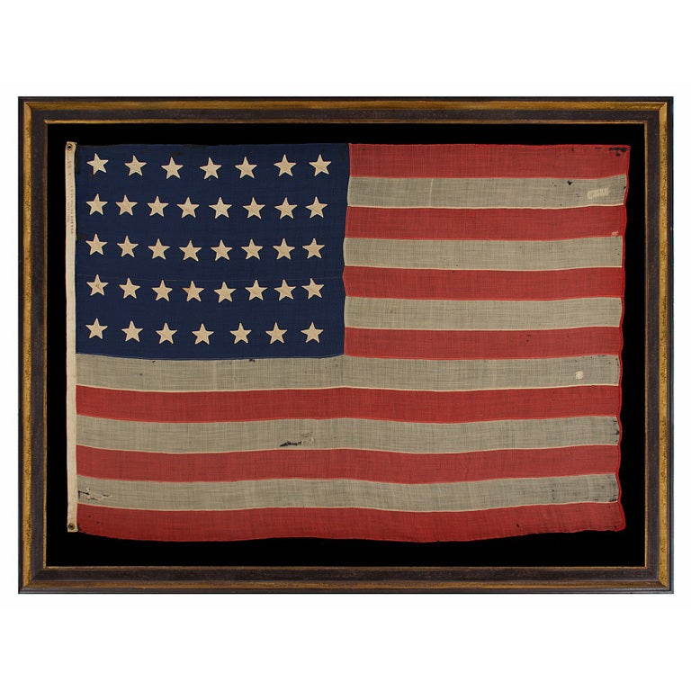 38 Hand-Sewn, Single-Appliqued Stars On a Flag For Sale