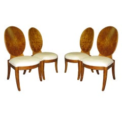 A set of 4 sable finished dining chairs.
