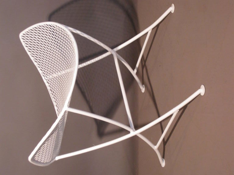 Wrought iron and steel mesh stool by the New York firm Salterini. New white painted finish. Seat height: 15.75